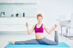 Smiling Woman Stretching at Home Stock Photos