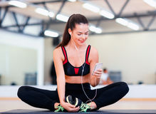 Smiling woman stretching on mat in the gym Royalty Free Stock Image