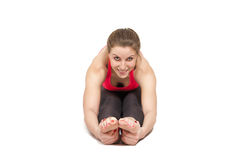 Smiling woman stretching Stock Photo