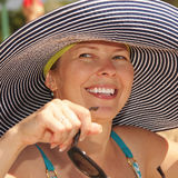 Smiling woman in striped hat Royalty Free Stock Photography