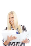 Smiling Woman in Striped Shirt Holding Open Binder. Smiling Blond Woman Wearing Striped Shirt Holding Open Binder in Studio with White Background Royalty Free Stock Photo