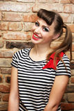 Smiling woman with striped T-shirt and a bow Stock Photography