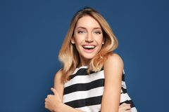 Smiling woman in striped top. On color background Royalty Free Stock Photography