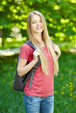Smiling woman student with backpack royalty free stock photography