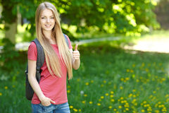 Smiling woman student with backpack stock photography