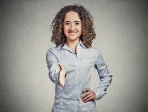 Smiling woman, student, customer service agent giving you handshake Stock Photography
