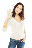 Smiling woman student with ok sign Stock Images