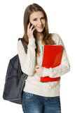 Smiling woman student talking on cell phone Stock Photo