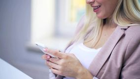 Smiling woman or student texting on smartphone stock video