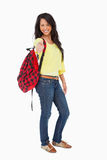 Smiling woman student thumb-up with a backpack. Against a white background Stock Photo