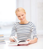 Smiling woman studying in college Royalty Free Stock Photography