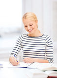 Smiling woman studying in college Stock Photos