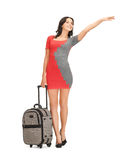 Smiling woman with suitcase. Picture of smiling woman in dress with suitcase hitchhiking Stock Image