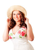 Smiling woman in summer dress and hat Stock Photos