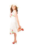Smiling woman in summer dress and hat Royalty Free Stock Photography