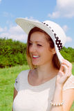 Smiling woman with summer hat. In nature Royalty Free Stock Image