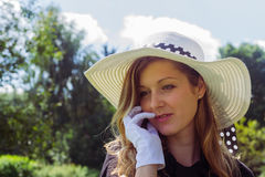 Smiling woman with summer hat. In nature Stock Images