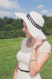 Smiling woman with summer hat. In nature Royalty Free Stock Images