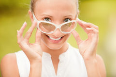 Smiling woman in sun glasses Stock Photo