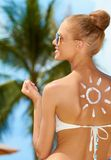 Smiling woman with the sun painted on her back Royalty Free Stock Photo