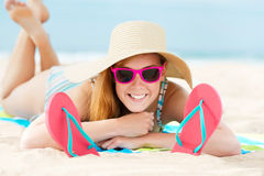 Smiling Woman Sunbathing On Beach Royalty Free Stock Photography