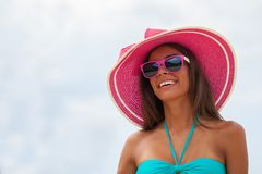 Smiling woman in sunhat. Portrait of a beautiful smiling young woman in bikini and sunhat Stock Photos