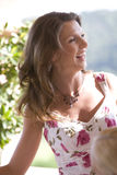 Smiling woman. On a sunny balcony royalty free stock images