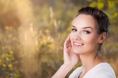 Smiling woman during sunny day Royalty Free Stock Photo