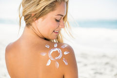 Smiling woman with sunscreen on her skin Royalty Free Stock Photography