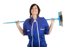 Smiling woman with sweeping brush Stock Photos