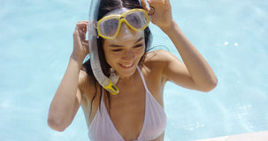 Smiling woman in swim suit wears goggles Royalty Free Stock Image