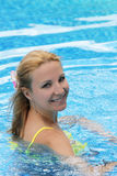 Smiling woman in swimming pool Royalty Free Stock Images
