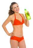 Smiling woman in swimsuit with bottle of water. Smiling young woman in swimsuit with bottle of water Stock Photo
