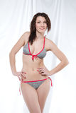 Smiling woman in swimsuit, drapery Royalty Free Stock Images