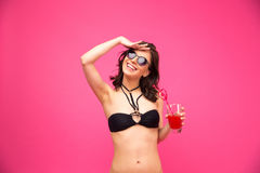 Smiling woman in swimsuit holding fresh juice Royalty Free Stock Images