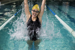 Smiling woman in swimsuit jumping. In the pool Royalty Free Stock Images