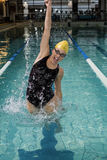 Smiling woman in swimsuit jumping. In the pool Royalty Free Stock Photography