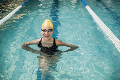 Smiling woman in swimsuit. In the pool Royalty Free Stock Photography