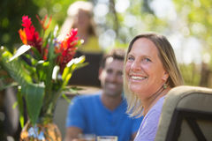 Smiling Woman at Table on Vacation Royalty Free Stock Photos