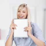 Smiling woman with tablet Royalty Free Stock Photos