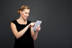 Smiling woman with tablet computer Stock Photo