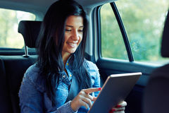 Smiling woman with tablet computer stock image