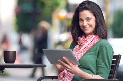 Smiling woman with tablet computer Royalty Free Stock Photo
