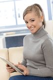 Smiling woman with tablet computer Stock Photography