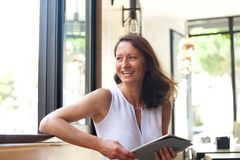 Smiling woman with tablet Stock Image