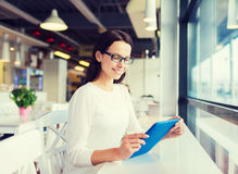 Smiling woman with tablet pc at cafe Stock Images