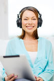 Smiling woman with tablet pc and headphones Stock Photos