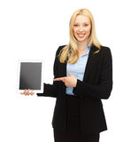 Smiling woman with tablet pc in office stock photo