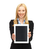Smiling woman with tablet pc in office Stock Photography