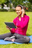 Smiling woman with tablet pc outdoors Stock Photos